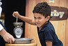 St. Matthew's Elementary student Ian Pagan put on his game face as he raced to beat principal Scottie Collier in a flour making contest. 10/20/16