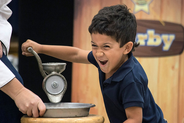 Ian Pagan of St. Matthew's Elementary reacts to his fellow classmates cheering against him during a flour grinding contest against principal Scottie Collier. 10/20/16