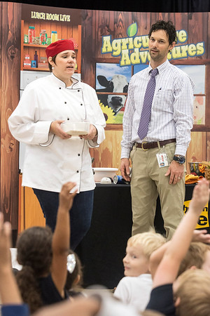 Jennifer Elwell persuades St. Matthew's Elementary principal Scottie Collier to participate in a contest to demonstrate the difference tools and machines can make when processing food. 10/20/16