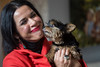 Stephanie Miller Slone receives a kiss from her dog Lulu. 10/21/16