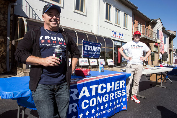 Trump supporters Jeff Klusmeier and Evan Wright man the merchandise tables at a rally in Fern Creek for the GOP candidate for president. 10/24/16