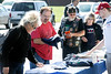 Trump fans check out the merchandise during a rally for the GOP presidential candidate in Fern Creek on Saturday. 10/22/16