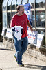 Gary Roberts takes a yard sign and a few shirts to show his support for Trump during a rally on Saturday. 10/22/16