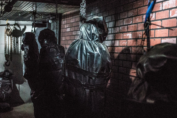 Hanging body bags adorn a dark basement hallway in the Baxter Avenue Morgue. 10/22/16