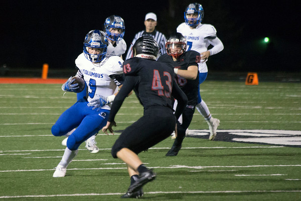 New Albany linebacker Tyler Triplett tries to stop Columbus North's tight end Tanner Payne during a playoff game on Friday night. 10/28/16