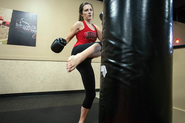 Brooklyn Willis delivers a kick during her workout at iLoveKickboxing on Hurstbourne Parkway. 11/01/16