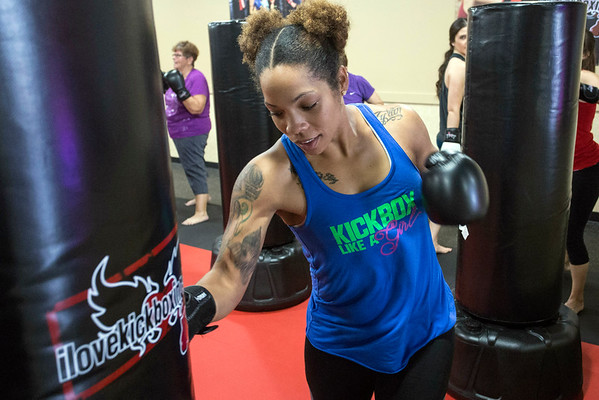 Class instructor Keaira Stokes throws a few punches during a recent iLoveKickboxing class. 11/01/16