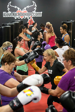 Participants pair off in the final stretch of an hour-long workout at iLoveKickboxing. 11/01/16