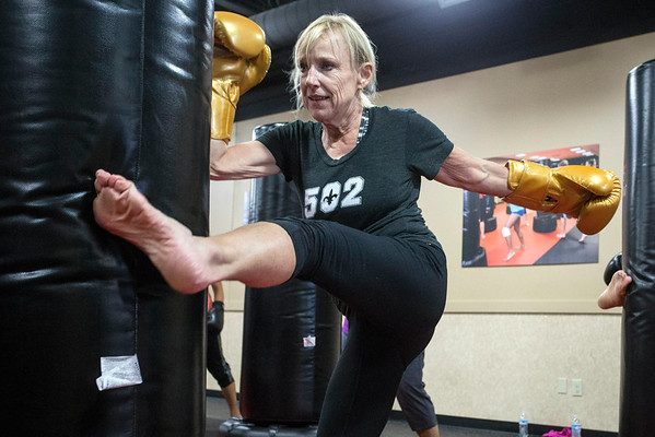 Kirby Adams delivers a high kick during an iLoveKickboxing class on Hurstbourne Parkway. 11/01/16