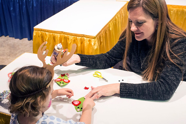 Melanie Minteer assists Mollie Bourke in a little holiday creativity at the 2016 Festival of Trees & Lights. 11/11/16