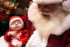 8-week-old Caleb Walker cracks a peaceful smile as he experiences the joy of Santa's lap for the first time at the 2016 Festival of Trees & Lights. 11/11/16