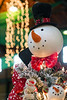 A snowman tree topper looks out over the showcase of holiday offerings at the 2016 Festival of Trees & Lights. 11/11/16