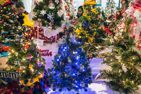 Heavily-decorated, tabletop trees were part of the hundreds of holiday trees on display at Slugger Field on Friday night. 11/11/16