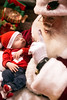 Santa Claus strikes the classic don't-wake-the-baby pose while holding 8-week-old Caleb Walker at the 2016 Festival of Trees & Lights. 11/11/16
