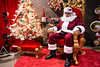 Santa Claus awaits the next round of children eager to request toys and mothers ready for a keepsake photo at the 2016 Festival of Trees & Lights. 11/11/16