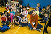 Family education teacher Grant Bridgewater and his class sit on the floor of the gym at the Americana Community Center listening to opening remarks on Tuesday. 11/15/16