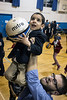 Andrew Gottworth gives Mohammed Fawzi a liitle help in getting to the basket during a community mixer at the Americana Center on Tuesday. 11/15/16