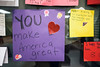 Handmade signs with more upbeat messages than those seen at recent protests adorn the walls in the entry at the Americana Community Center. 11/15/16
