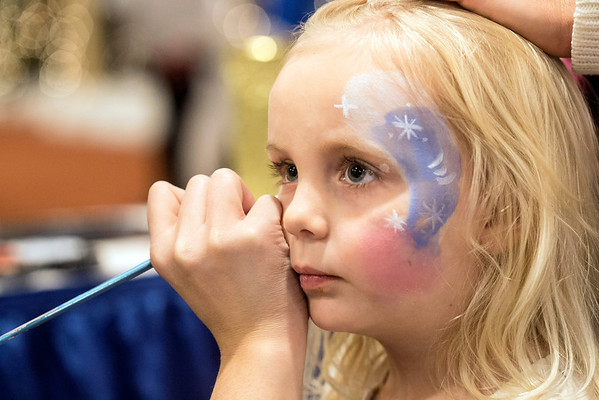 Daisy Sizemore takes advantage of the face painting booth during Christmas at the Galt House on Saturday. 11/19/16