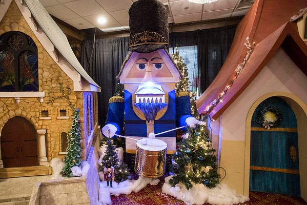 A nutcracker sits amongst the large scale model homes that comprise the Christmas Village at the Galt House. 11/19/16