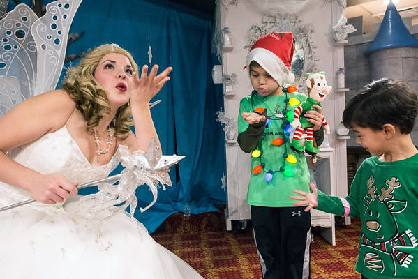 Snow Fairy Princess Hollie Nall demonstrates how to make a wish blowing fairy dust to the Mastromichalis brothers of St. Louis, MO during Christmas at the Galt House. 11/19/16