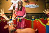 Elf Sara Bishop awaits the next challenger in the Reindeer Ring Toss during the Christmas at the Galt House. 11/19/16