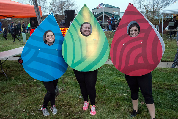 Lauren Pope, Nikki Robins and Amanda Grinnan of Elements Massage (a co-sponsor fo the 46th Annual Turkey Trot) get ready to cheer on participants in the 10k and 5k. 11/24/16