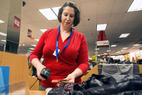 Kohl's employee Ann Metzler scans another item on Black Friday morning. 11/25/16