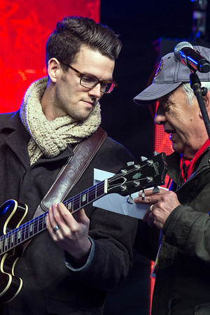 Singer Dave Moisan talks to Light Up Louisville producer Wayne Hettinger during a sound check for Friday's events on Jefferson Street. 11/25/16
