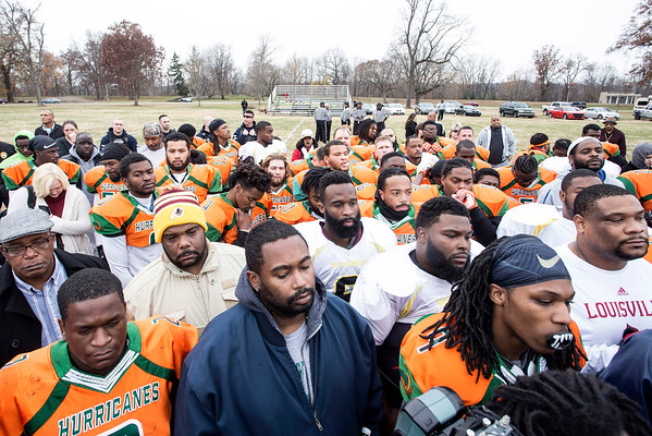 Participants in the Juice Bowl finale in Shawnee Park on Saturday afternoon gather for a pre-game prayer. 12/3/16