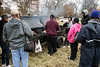 People gathered around a grill for fresh food during the Juice Bowl at Shawnee Park on Saturday afternoon. 12/3/16