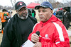 John Cole and Carl Rodgers discuss details before the start of the Juice Bowl championship game on Saturday. 12/3/16