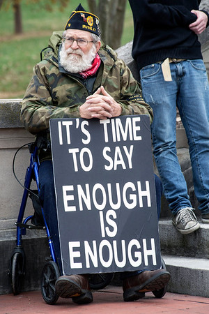 Buck Winburn uses a sign to convey his feelings during a rally on the steps of the Kentucky State Capitol Building on Sunday. 12/4/16