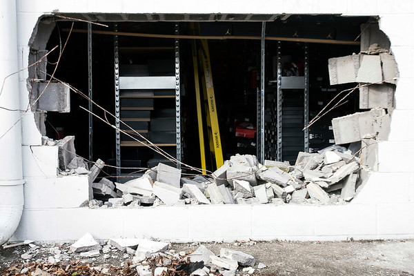 Burglars left a gaping hole in the rear of the City Gear store at the Tradewinds West Shopping Center on Cane Run Road after a successful overnight smash-and-grab. 12/7/16