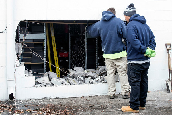 Property management workers at the Tradewinds West Shopping Center on Cane Run Road started Wednesday morning removing busted cinder blocks from a brazen burglary at City Gear. 12/7/16
