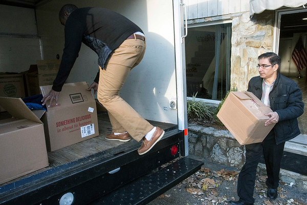 Muhammad Babar loads a rental truck with donations collected for Gatlinburg fire victims at the Muslim Americans for Compassion headquarters on Waldoah Beach. 12/8/16