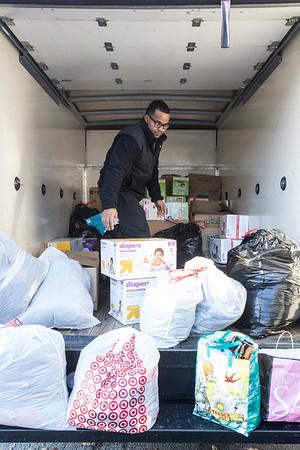 Farhan Abdi sorts and organizes donations heading to Gatlinburg fire victims on Thursday morning. 12/8/16