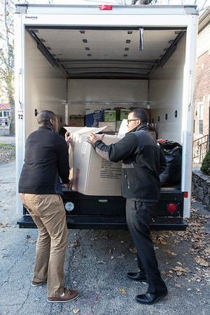 Mohamed Ali and Farhan Abdi load a rental truck on Thursday morning with donations heading to Gatlinburg fire victims. 12/8/16