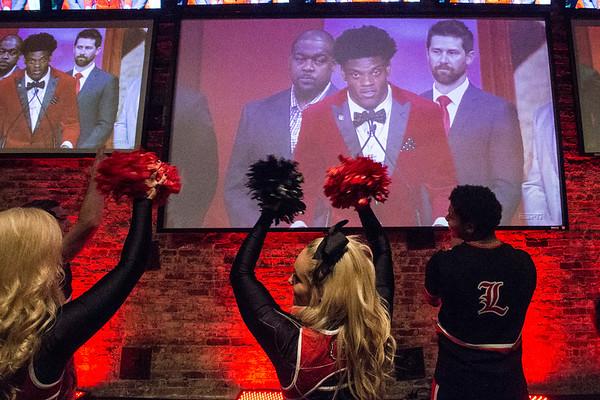 The UofL cheerleaders applauded Lamar Jackson as he gave his Heisman acceptance speech on multiple screens at Sports & Social Club on Saturday night. 12/10/16
