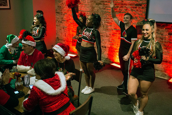 The UofL cheerleaders riled the fans at Sports & Social Club on Saturday night with cheers during commercial breaks of the Heisman Trophy broadcast. 12/10/16