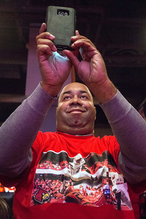 UofL fan James Carr records the Heisman announcement on his phone as Lamar Jackson became the first Louisville player to win the coveted award. 12/10/16