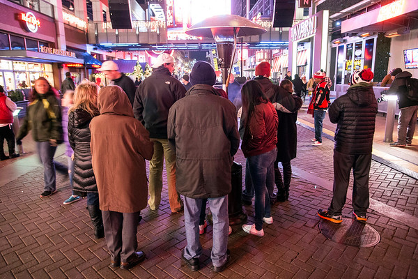 A few dozen fans watched the Heisman announcement at Fourth Street Live on the big screen as UofL's Lamar Jackson became the school's first winner of college football's top prize. 12/10/16