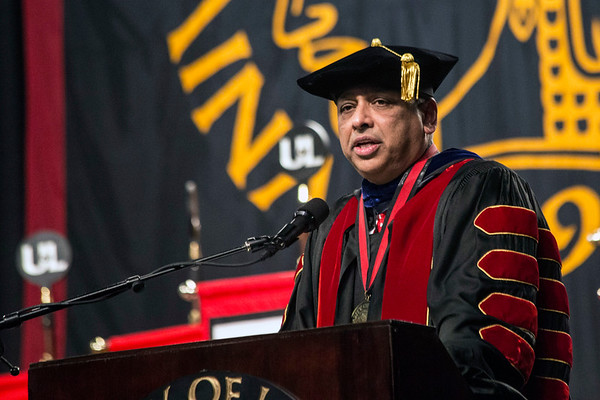 Acting UofL president Dr. Neville Pinto delivers words of advice to the graduates at the winter commencement on Thursday night. 12/15/16