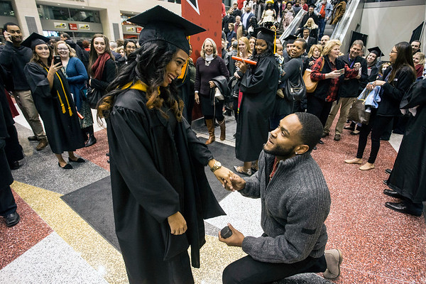 UofL graduate Kimberly Kelly received an added bonus on commencement night as her boyfriend Matthew McNair proposed marriage to her at the KFC Yum Center. 12/15/16