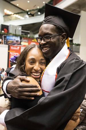 Cortnee Walton, of the UofL women's basketball team, hugs Mangok Mathiang, of the men's basketball team, upon his graduation from UofL on Thursday night. 12/15/16