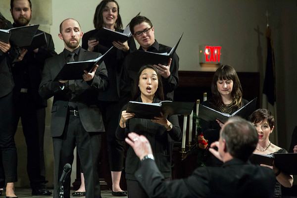 Louisville Chamber Choir alto Hyunjin Kwak takes the lead during the Songs of Christmas Night show at St. Paul United Methodist on Saturday. 12/17/16