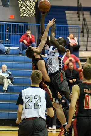 Waggener's Jaago Kalakon goes strong for the basket against Bullitt East. 12/21/16