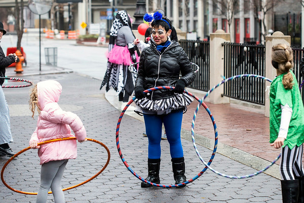 Anita Yussman gave hula hoop lessons to children in front of Slugger Museum during Lou Year's Eve on Saturday afternoon. 12/31/16