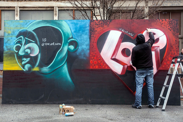 Artist Wilfred Sieg III worked on a mural along Main Street during Lou Year's Eve. 12/31/16