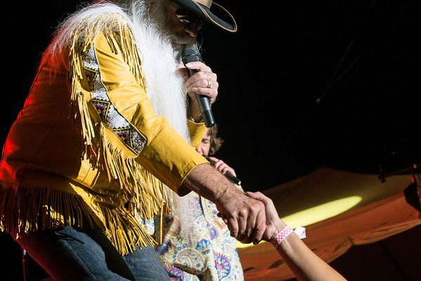 The Oak Ridge Boys' William Lee Golden extends a handshake to an audience member during the band's Kentucky State Fair concert on Sunday night. 8/21/16